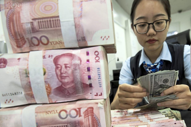 Đồng Nhân Dân Tệ có thể suy yếu đến mức 7,40 so với đồng USD khi căng thẳng  Mỹ-Trung kéo dài